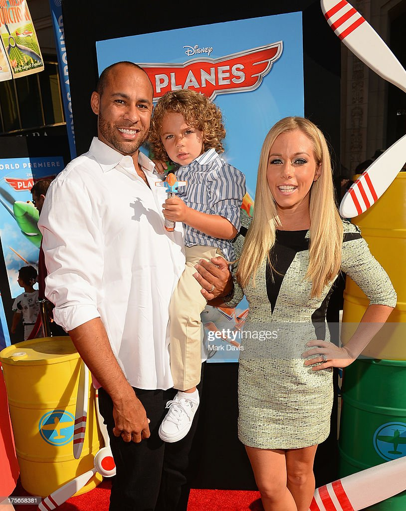 Former NFL Player <a gi-track='captionPersonalityLinkClicked' href=/galleries/search?phrase=Hank+Baskett&family=editorial&specificpeople=749185 ng-click='$event.stopPropagation()'>Hank Baskett</a> III, son <a gi-track='captionPersonalityLinkClicked' href=/galleries/search?phrase=Hank+Baskett&family=editorial&specificpeople=749185 ng-click='$event.stopPropagation()'>Hank Baskett</a> IV and wife/TV Personality <a gi-track='captionPersonalityLinkClicked' href=/galleries/search?phrase=Kendra+Wilkinson&family=editorial&specificpeople=539064 ng-click='$event.stopPropagation()'>Kendra Wilkinson</a> Baskett attend the premiere of Disney's 'Planes' at the El Capitan Theatre on August 5, 2013 in Hollywood, California.