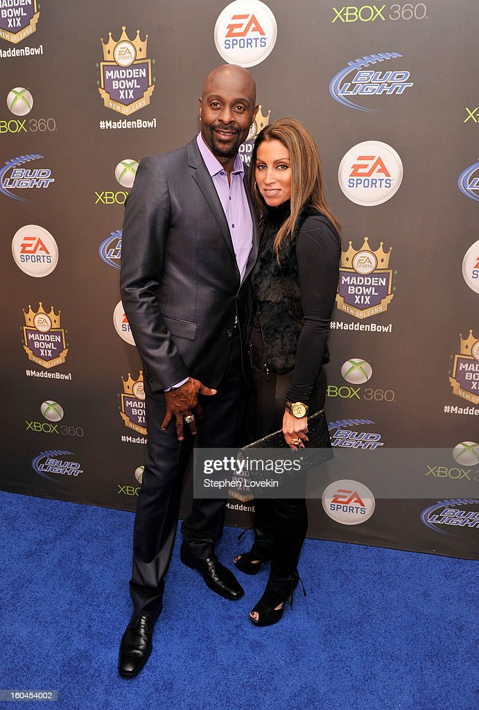 Former NFL player <a gi-track='captionPersonalityLinkClicked' href=/galleries/search?phrase=Jerry+Rice&family=editorial&specificpeople=184559 ng-click='$event.stopPropagation()'>Jerry Rice</a> and Latisha Pelayo arrive at EA SPORTS Madden Bowl XIX at the Bud Light Hotel on January 31, 2013 in New Orleans, Louisiana.