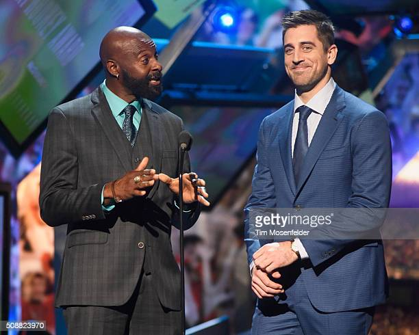 Former NFL player Jerry Rice and NFL player Aaron Rodgers speak onstage during the 5th Annual NFL Honors at Bill Graham Civic Auditorium on February...
