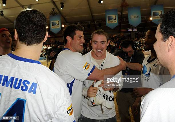 Former NFL player Jesse Palmer celebrates with NFL player Colt McCoy of the Cleveland Browns during DIRECTV's Fifth Annual Celebrity Beach Bowl at...