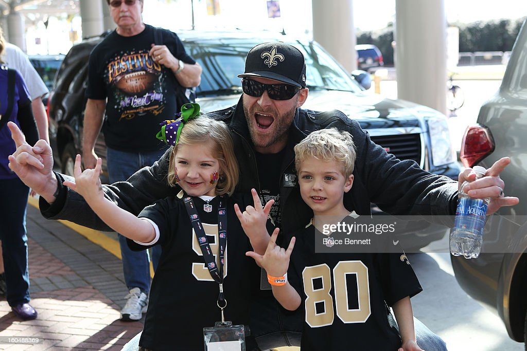 Former NFL player Kyle Turley poses with fans Caden and Mayci Vallee outside the Ernest N. Morial Convention Center on February 1, 2013 in New Orleans, Louisiana.