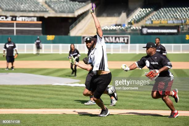 Former NFL player Lorenzo Neal tags out Golden State Warrior JaVale McGee during JaVale McGees JUGLIFE charity softball game on June 24 at...