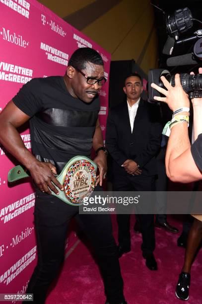 Former NFL player Michael Irvin poses with the WBC Money Belt on TMobile's magenta carpet duirng the Showtime WME IME and Mayweather Promotions VIP...