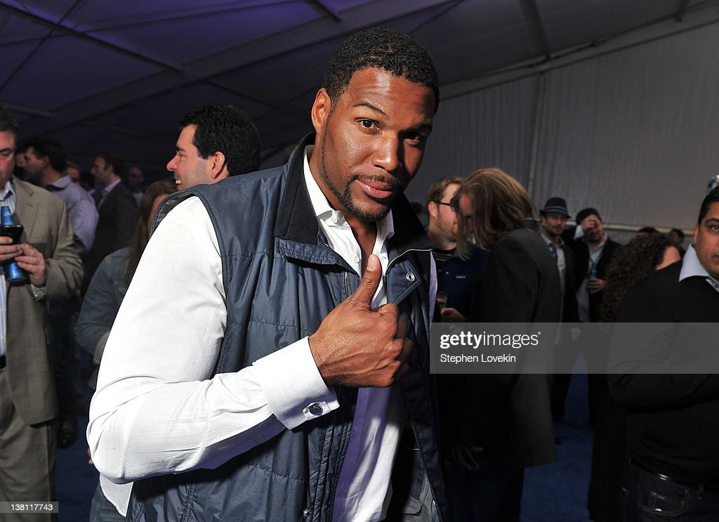Former NFL player Michael Strahan attends EA SPORTS Madden Bowl kicks off the Bud Light Hotel at the Bud Light Hotel on February 2 2012 in...