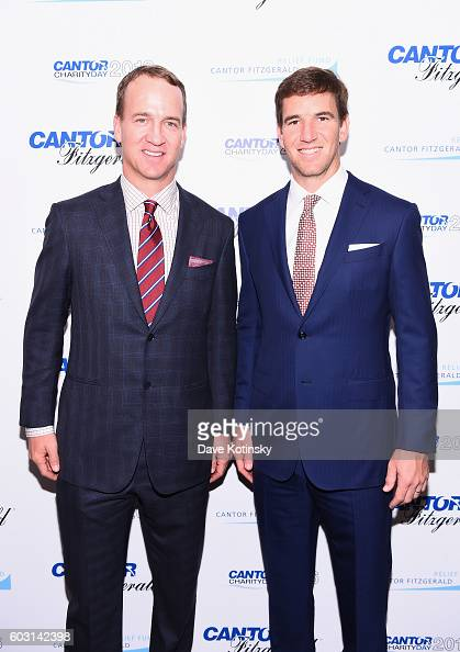 Former NFL player Peyton Manning and NY Giants NFL player Eli Manning attend the Annual Charity Day hosted by Cantor Fitzgerald BGC and GFI at Cantor...
