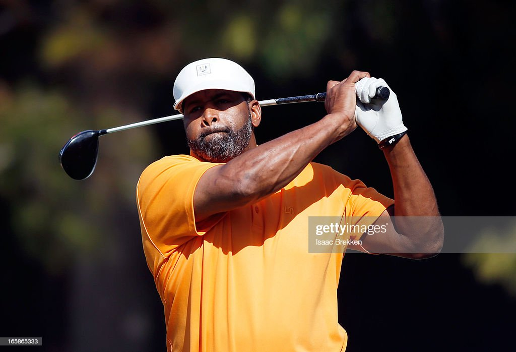 Former NFL player <a gi-track='captionPersonalityLinkClicked' href=/galleries/search?phrase=Richard+Dent&family=editorial&specificpeople=240277 ng-click='$event.stopPropagation()'>Richard Dent</a> hits a tee shot during ARIA Resort & Casino's Michael Jordan Celebrity Invitational golf tournament at Shadow Creek on April 6, 2013 in North Las Vegas, Nevada.