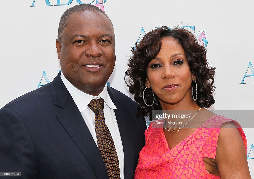 Former NFL player Rodney Peete (L) and wife actress Holly Robinson Peete attend The Associates For Breast and Prostate Cancer Studies' Annual Mother's Day Luncheon at the Four Seasons Hotel Los Angeles at Beverly Hills on May 8, 2013 in Beverly Hills, California.