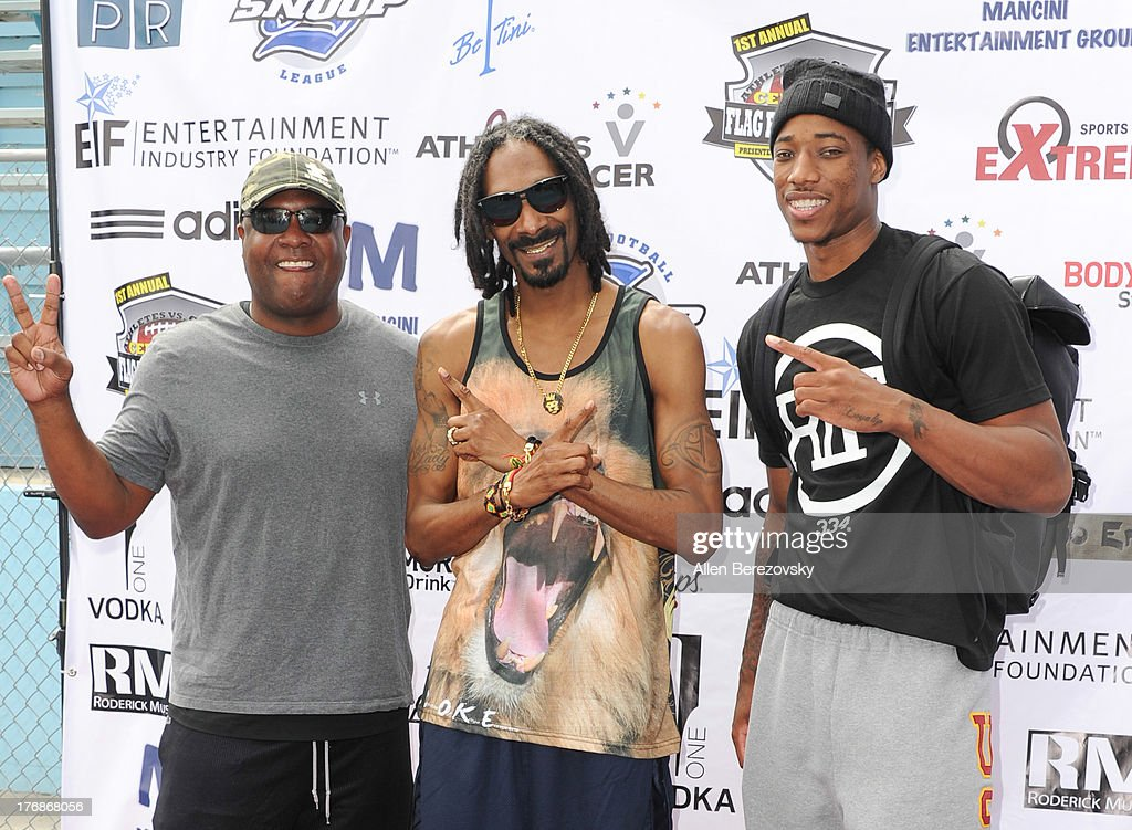 Former NFL player Rodney Peete, recording artist Snoop Dogg and NBA player DeMar DeRozan attend the 1st Annual Athletes VS Cancer Celebrity Flag Football Game on August 18, 2013 in Pacific Palisades, California.