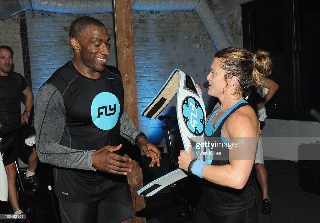 Former NFL player <a gi-track='captionPersonalityLinkClicked' href=/galleries/search?phrase=Shannon+Sharpe&family=editorial&specificpeople=209398 ng-click='$event.stopPropagation()'>Shannon Sharpe</a> and trainer Holly Rilinger attend The Flywheel Challenge at the NFL House hosted by <a gi-track='captionPersonalityLinkClicked' href=/galleries/search?phrase=Shannon+Sharpe&family=editorial&specificpeople=209398 ng-click='$event.stopPropagation()'>Shannon Sharpe</a> at The Chicory on February 1, 2013 in New Orleans, Louisiana.