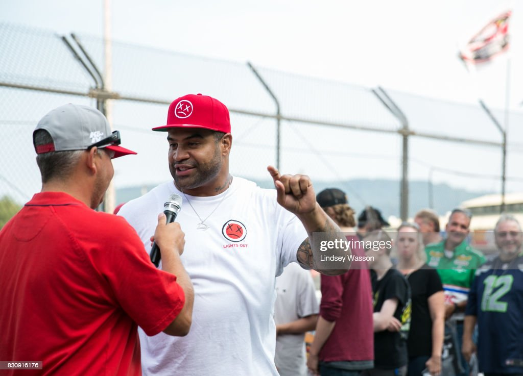 Former NFL player Shawne Merriman, right, is interviewed before the NASCAR K&N Pro Series West NAPA Auto Parts 150 on August 12, 2017 at Evergreen Speedway in Monroe, Washington.