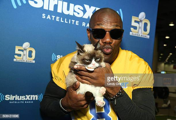 Former NFL player Terrell Owens and Grumpy Cat attend SiriusXM at Super Bowl 50 Radio Row at the Moscone Center on February 4 2016 in San Francisco...