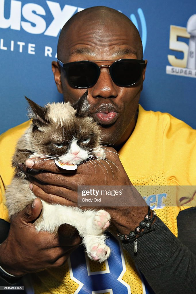 Former NFL player Terrell Owens and Grumpy Cat visit the SiriusXM set at Super Bowl 50 Radio Row at the Moscone Center on February 4 2016 in San...