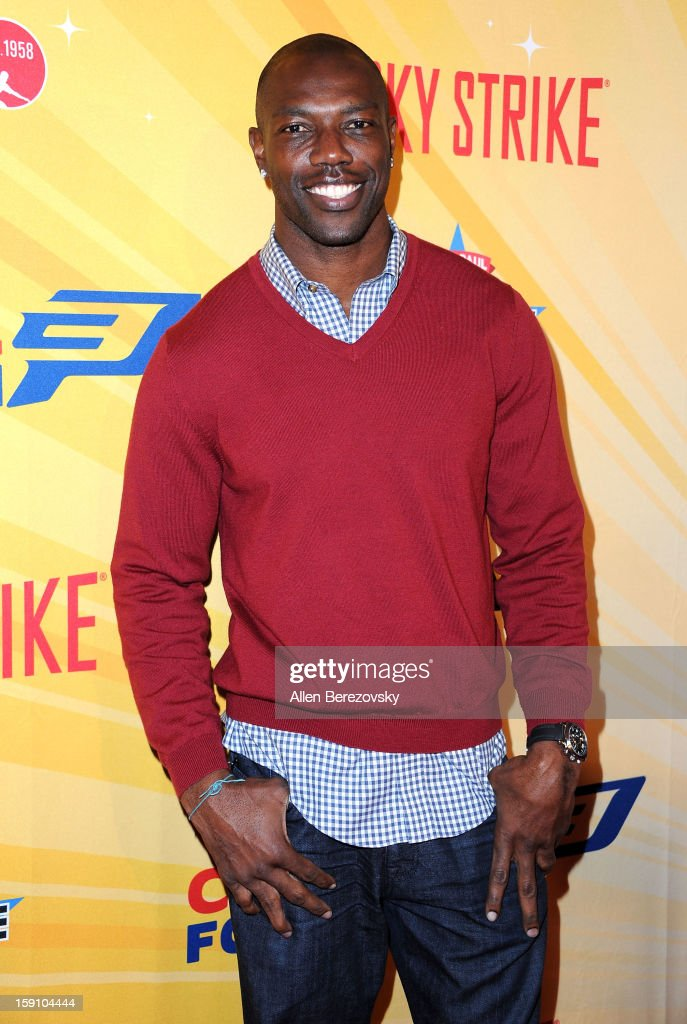 Former NFL player Terrell Owens arrives at the 5th annual Chris Paul PBA All-Stars Invitational hosted by LA Clippers star guard Chris Paul at Lucky Strike Lanes at L.A. Live on January 7, 2013 in Los Angeles, California.