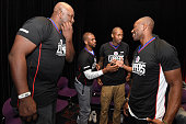 Former NFL player Terrell Owens shakes hands with Chris Paul of the Los Angeles Clippers at the 16th annual Charity BasketBowl Challenge at Keystone...