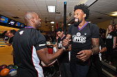 Former NFL player Terrell Owens shakes hands with DeAndre Jordan of the Los Angeles Clippers at the 16th annual Charity BasketBowl Challenge at...