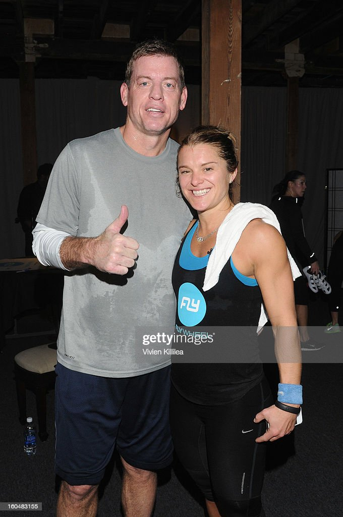 Former NFL Player <a gi-track='captionPersonalityLinkClicked' href=/galleries/search?phrase=Troy+Aikman&family=editorial&specificpeople=206871 ng-click='$event.stopPropagation()'>Troy Aikman</a> and trainer Holly Rilinger attend The Flywheel Challenge at the NFL House hosted by Shannon Sharpe at The Chicory on February 1, 2013 in New Orleans, Louisiana.
