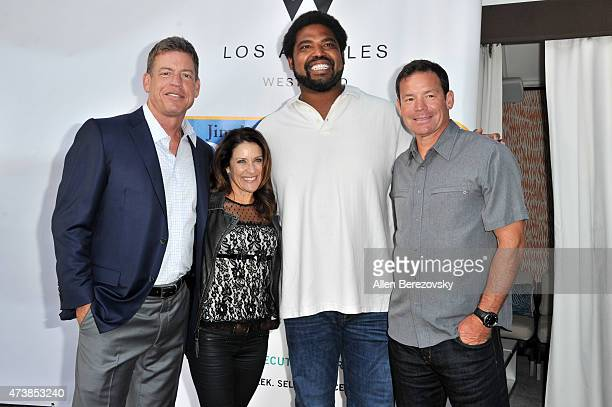 Former NFL player Troy Aikman Shannon Mora former NFL player Jonathan Ogden and oach Jim Mora Jr and wife attend the 9th annual Jim Mora Celebrity...