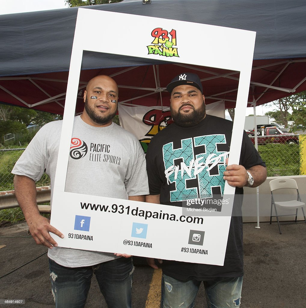 Former NFL players Maake Kemoeatu and Chris Kemoeatu pose for pictures at the Pacific Elite Sports Fitness Center Grand Opening on January 24 2014 in...