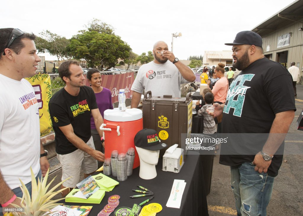 Former NFL players Maake Kemoeatu and Chris Kemoeatu try the refreshments at the Pacific Elite Sports Fitness Center Grand Opening on January 24 2014...