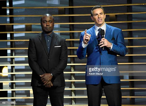 Former NFL players Marshall Faulk and Kurt Warner speak onstage at AE Networks 'Shining A Light' concert at The Shrine Auditorium on November 18 2015...