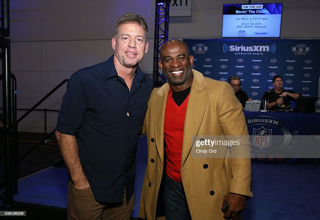 Former NFL players with the Dallas Cowboys Troy Aikman and Deion Sanders visit the SiriusXM set at Super Bowl 50 Radio Row at the Moscone Center on...