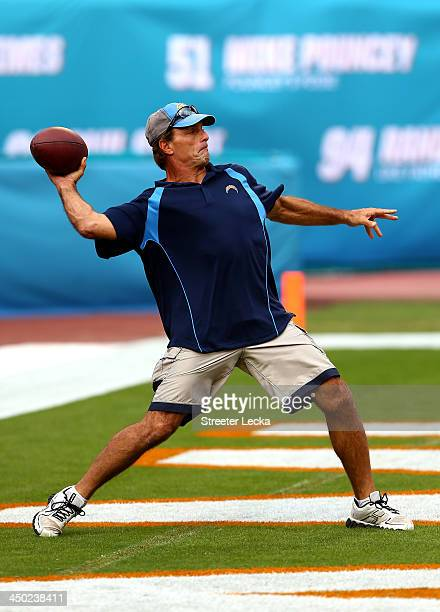 Former NFL quarterback Doug Flutie throws a ball during warmups before the game between the San Diego Chargers and Miami Dolphins at Sun Life Stadium...