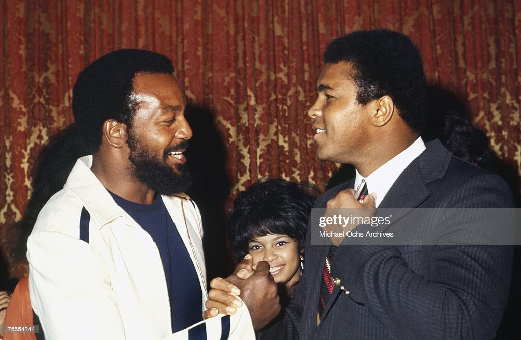 Former NFL superstar Jim Brown greets heavyweight boxer Muhammad Ali at an event in New York, New York in November 1971. Four years earlier, in the wake of the controversy following Ali's decision not to fight in Vietnam, Brown held a summit of prominent African-American athletes to support Ali.