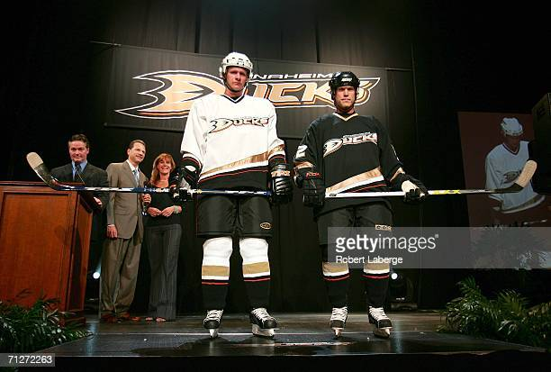 Former NHL goaltender Bryan Hayward Ducks Owners Henry Samuelis and Susan Samuelis look on as Anaheim Ducks players Corey Perry and Todd Marchant...