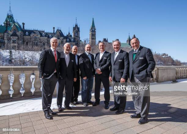 Former NHL greats Mike Bossy Bernie Parent Dave Keon Bryan Trottier Paul Coffey Guy Lafleur and Frank Mahovlich pose for a photo in front of...