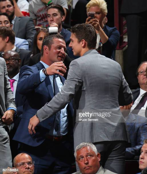 Former NHL player Adam Foote congratulates his son Callan on his selection by the Tampa Bay Lightning during the 2017 NHL Draft at the United Center...