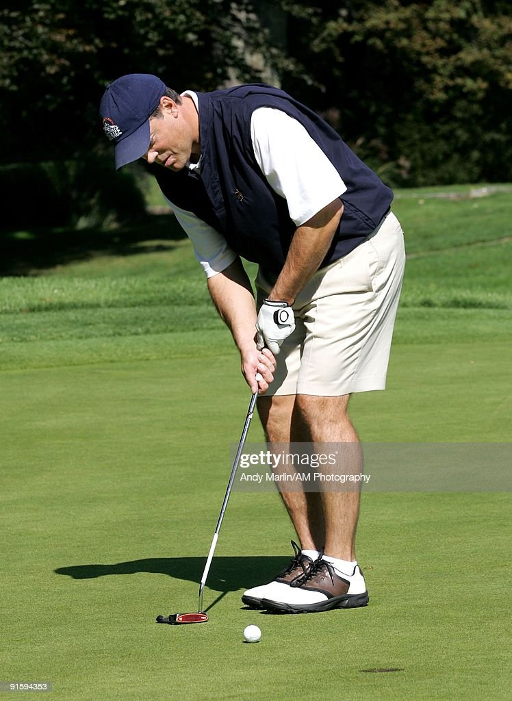 Former NHL player and a member of the NHL Hall of Fame and event host Pat LaFontaine putts the ball at the 7th Annual Companions in Courage Foundation Golf Classic at Deepdale Golf Club on October 5, 2009 in Manhasset, New York.