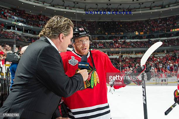 Former NHL player and current hockey analyst Jeremy Roenick interviews Marian Hossa of the Chicago Blackhawks before Game Two of the Stanley Cup...