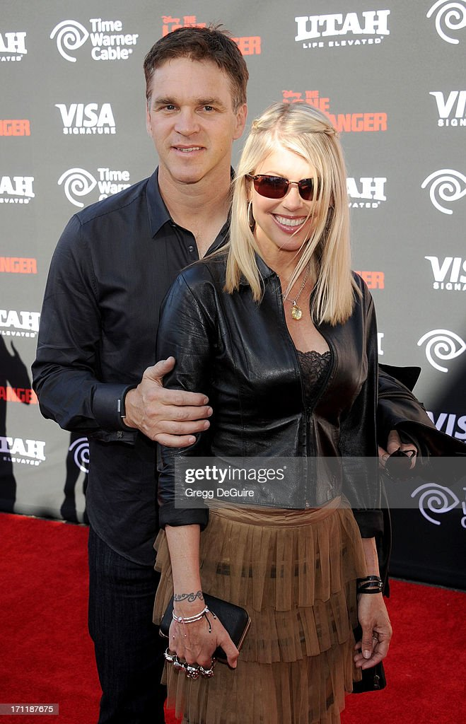 Former NHL player and L.A. Kings President, Business Operations Luc Robitaille and actress/wife Stacey Toten arrive at 'The Lone Ranger' World Premiere at Disney's California Adventure on June 22, 2013 in Anaheim, California.
