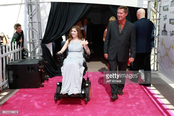 Former NHL player Bobby Carpenter right and Denna Laing arrive on the magenta carpet for the 2017 NHL Awards at TMobile Arena on June 21 2017 in Las...