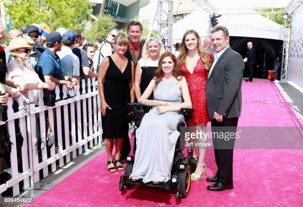 Former NHL player Bobby Carpenter second from left Denna Laing third from right and guests arrive on the magenta carpet for the 2017 NHL Awards at...