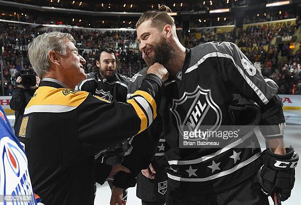 Former NHL player Bobby Orr tugs at the beard of Brent Burns of the San Jose Sharks prior to the 2017 Honda NHL AllStar Game at Staples Center on...