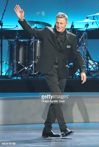 Former NHL player Borje Salming waves to the audience as he takes the stage during the NHL 100 presented by GEICO show as part of the 2017 NHL...