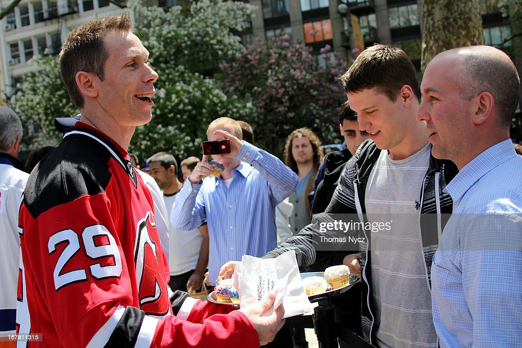 Former NHL player <a gi-track='captionPersonalityLinkClicked' href=/galleries/search?phrase=Grant+Marshall&family=editorial&specificpeople=201701 ng-click='$event.stopPropagation()'>Grant Marshall</a> passes out NHL and NBC Sports themed cupcakes during a 2013 Stanley Cup Playoffs kickoff event at Madison Square Park on April 30, 2013 in New York City. The NHL, NBC Sports and Crumbs Bake Shop hosted the event to celebrate the start of the 2013 Stanley Cup Playoffs.