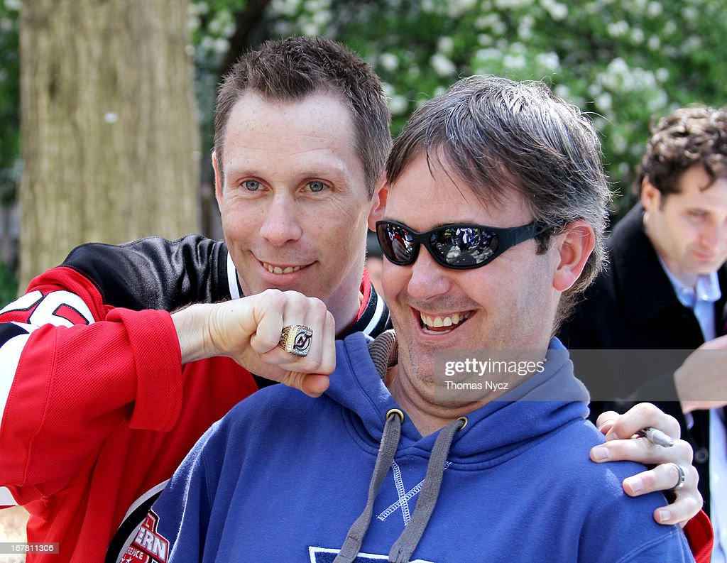 Former NHL player Grant Marshall poses for photographs with a Rangers fan during a 2013 Stanley Cup Playoffs kickoff event at Madison Square Park on April 30, 2013 in New York City. The NHL, NBC Sports and Crumbs Bake Shop hosted the event to celebrate the start of the 2013 Stanley Cup Playoffs.