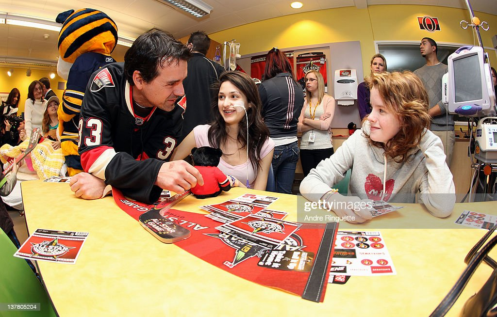 Former NHL Player <a gi-track='captionPersonalityLinkClicked' href=/galleries/search?phrase=Jason+York&family=editorial&specificpeople=202969 ng-click='$event.stopPropagation()'>Jason York</a> visits with young patients at the unveiling of the NHL All-Star Legacy Playroom at Children's Hospital of Eastern Ontario on January 27, 2012 in Ottawa, Canada.