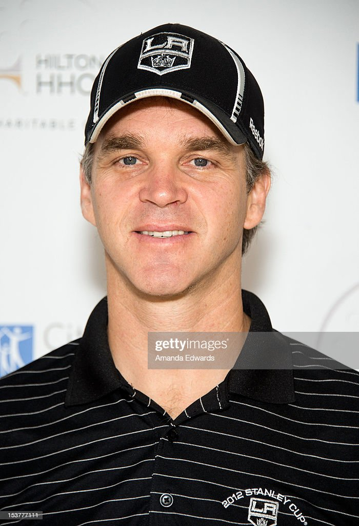 Former NHL player <a gi-track='captionPersonalityLinkClicked' href=/galleries/search?phrase=Luc+Robitaille&family=editorial&specificpeople=202471 ng-click='$event.stopPropagation()'>Luc Robitaille</a> arrives at the 6th Annual Hilton HHonors Charitable Golf Series at The Riviera Country Club on October 8, 2012 in Pacific Palisades, California.