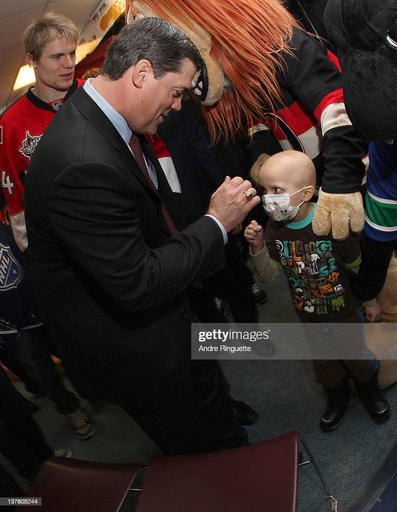 Former NHL Player <a gi-track='captionPersonalityLinkClicked' href=/galleries/search?phrase=Pat+LaFontaine&family=editorial&specificpeople=213982 ng-click='$event.stopPropagation()'>Pat LaFontaine</a> visits with a young patient at the unveiling of the NHL All-Star Legacy Playroom at Children's Hospital of Eastern Ontario on January 27, 2012 in Ottawa, Canada.