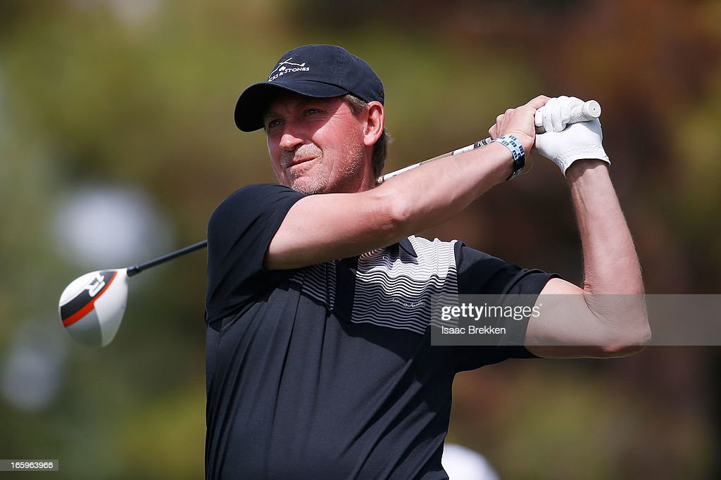 Former NHL player Wayne Gretzky hits a tee shot during the final round of ARIA Resort & Casino's Michael Jordan Celebrtiy Invitational golf tournament at Shadow Creek on April 7, 2013 in North Las Vegas, Nevada.