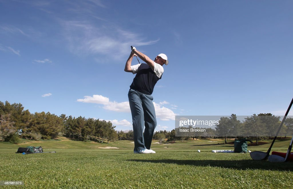 Former NHL player Wayne Gretzky hits on the driving range during Aria Resort & Casino's 13th Annual Michael Jordan Celebrity Invitational at Shadow Creek on April 5, 2014 in North Las Vegas, Nevada.