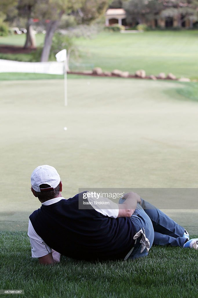 Former NHL player Wayne Gretzky lies on the 18th green during Aria Resort & Casino's 13th Annual Michael Jordan Celebrity Invitational at Shadow Creek on April 5, 2014 in North Las Vegas, Nevada.