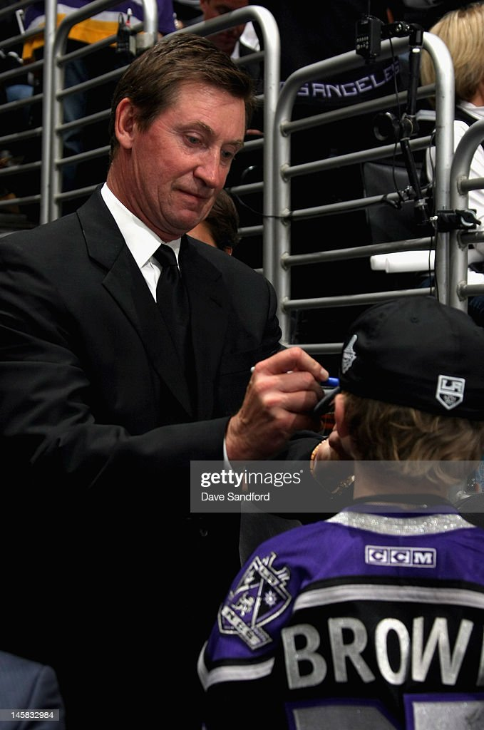 Former NHL player Wayne Gretzky signs an autograph during Game Four of the 2012 Stanley Cup Final at the Staples Center on June 6, 2012 in Los Angeles, California.