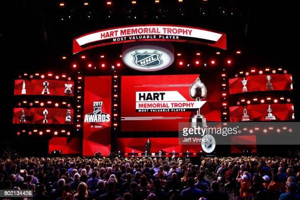 Former NHL player Wayne Gretzky speaks onstage to announce the recipient of the Hart Memorial Trophy during the 2017 NHL Awards Expansion Draft at...