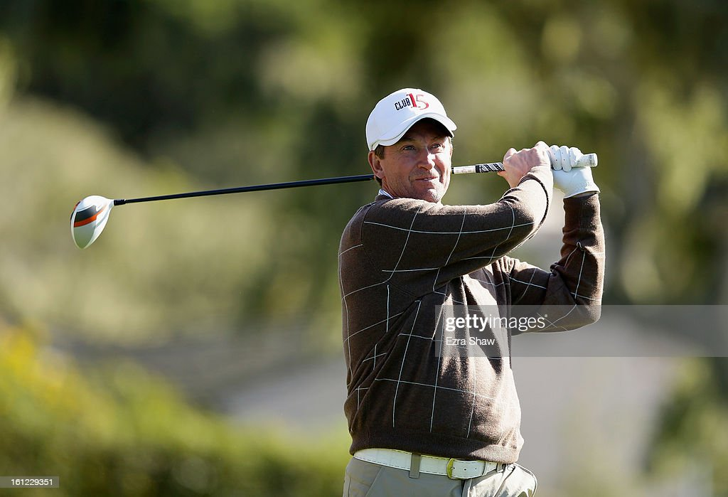 Former NHL player Wayne Gretzky tees off on the 15th hole during the third round of the AT&T Pebble Beach National Pro-Am at Pebble Beach Golf Links on February 9, 2013 in Pebble Beach, California.