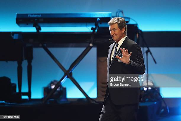 Former NHL player Wayne Gretzky walks on stage during the NHL 100 presented by GEICO Show as part of the 2017 NHL AllStar Weekend at the Microsoft...