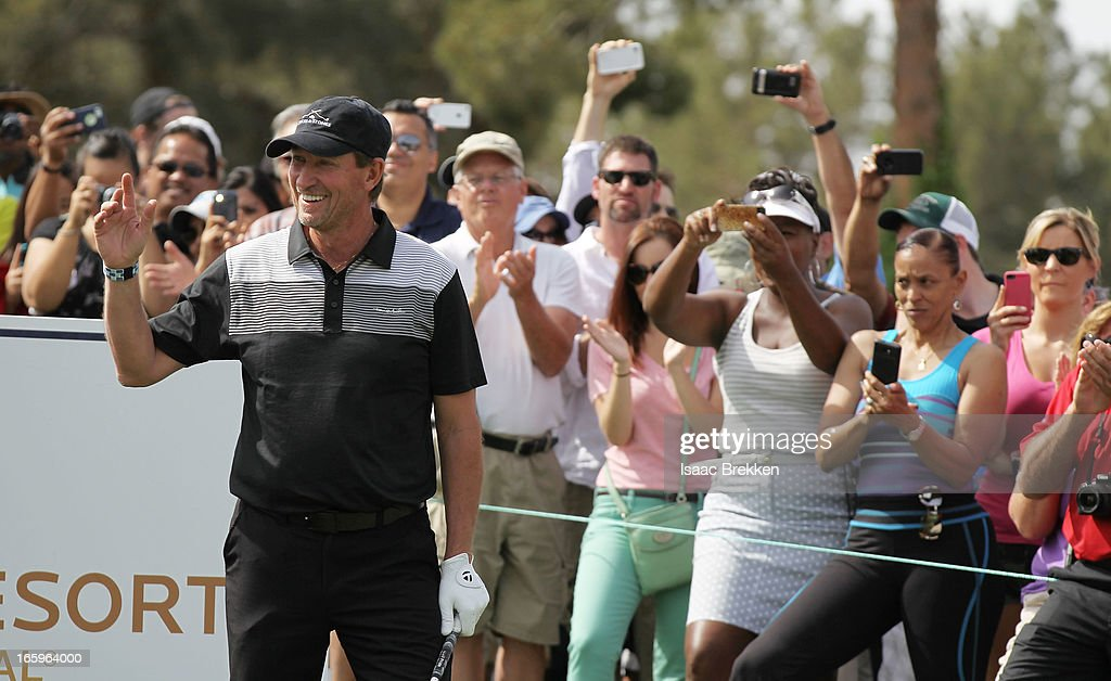 Former NHL player Wayne Greztky waves to the crowd during the final round of ARIA Resort & Casino's Michael Jordan Celebrtiy Invitational golf tournament at Shadow Creek on April 7, 2013 in North Las Vegas, Nevada.